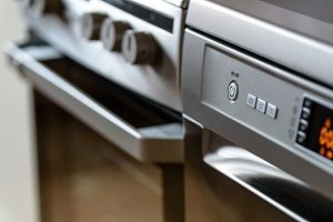 Metallic stove and dishwasher in the kitchen